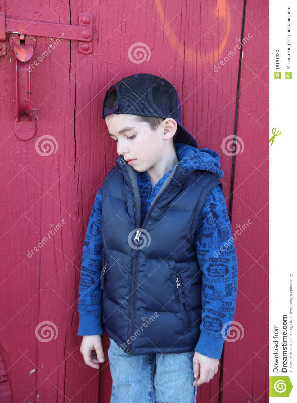 sad boy red door stock image image of youngster young