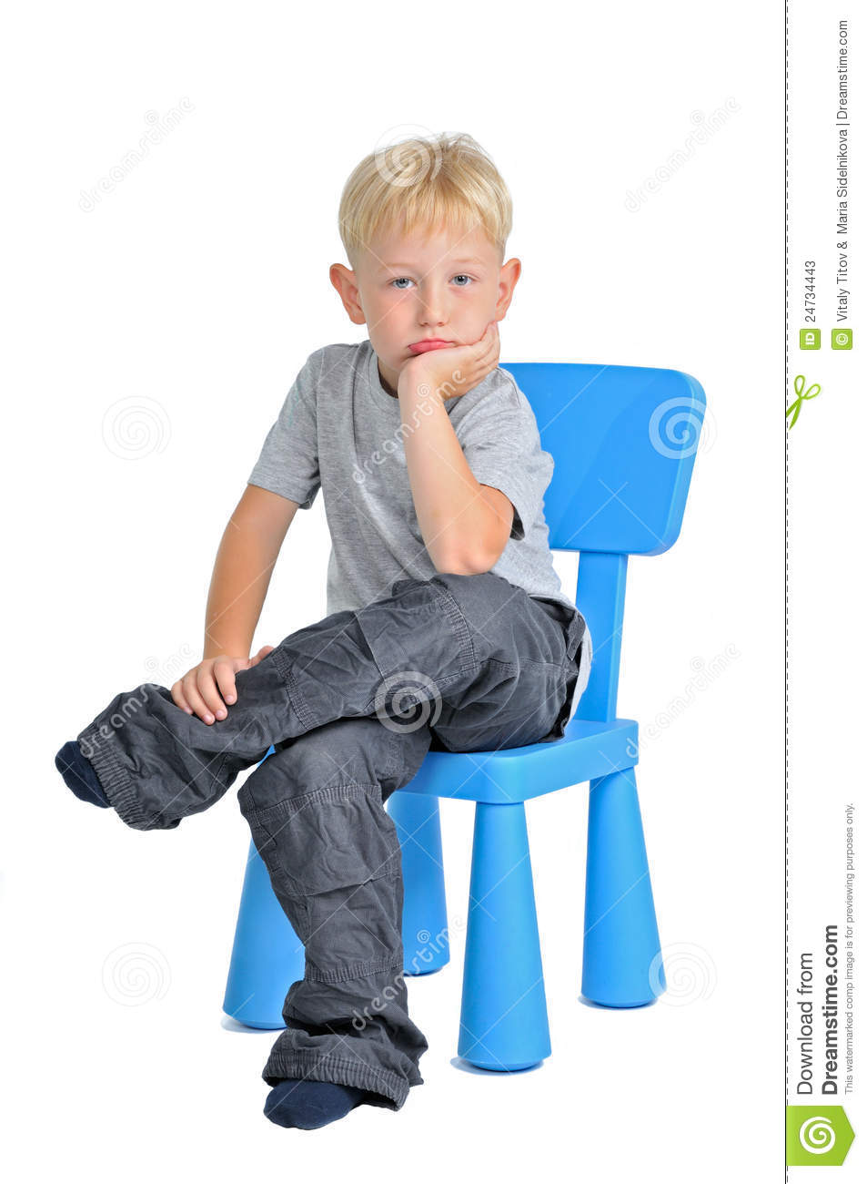 Sad Boy Sitting On A Chair Stock Photos - Image: 24734443