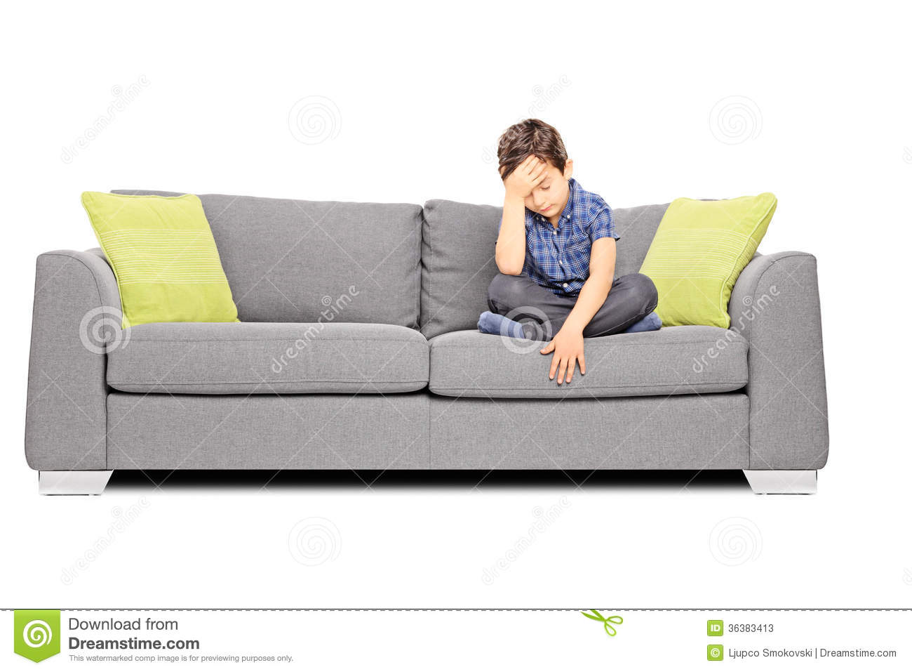 sad boy sitting on a couch stock photos image 36383413. Black Bedroom Furniture Sets. Home Design Ideas
