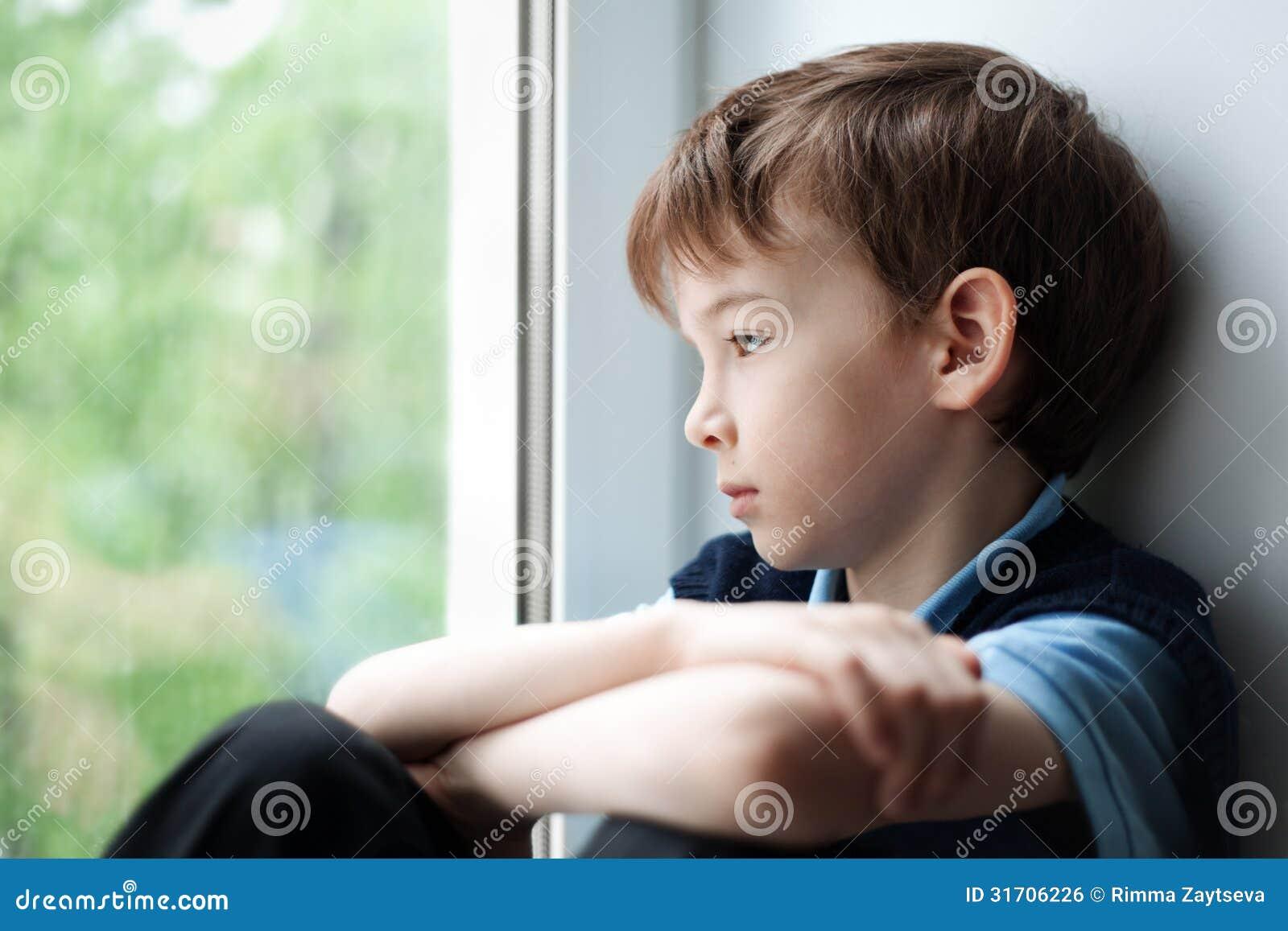 Sad Boy Sitting On Window Stock Photo Image Of Sneakers