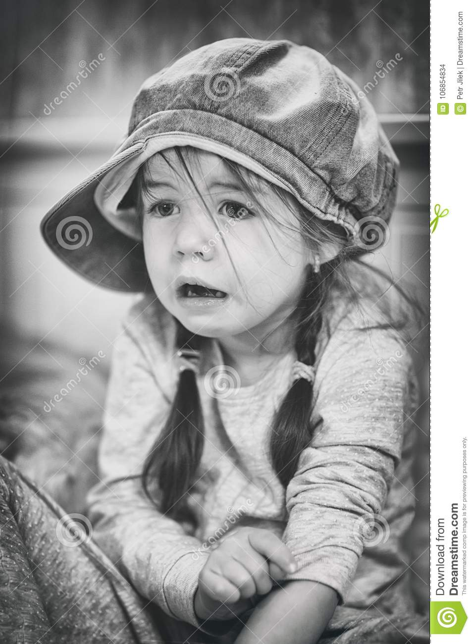 Sad child, black-white, sufferingLittle girl with fear in the face