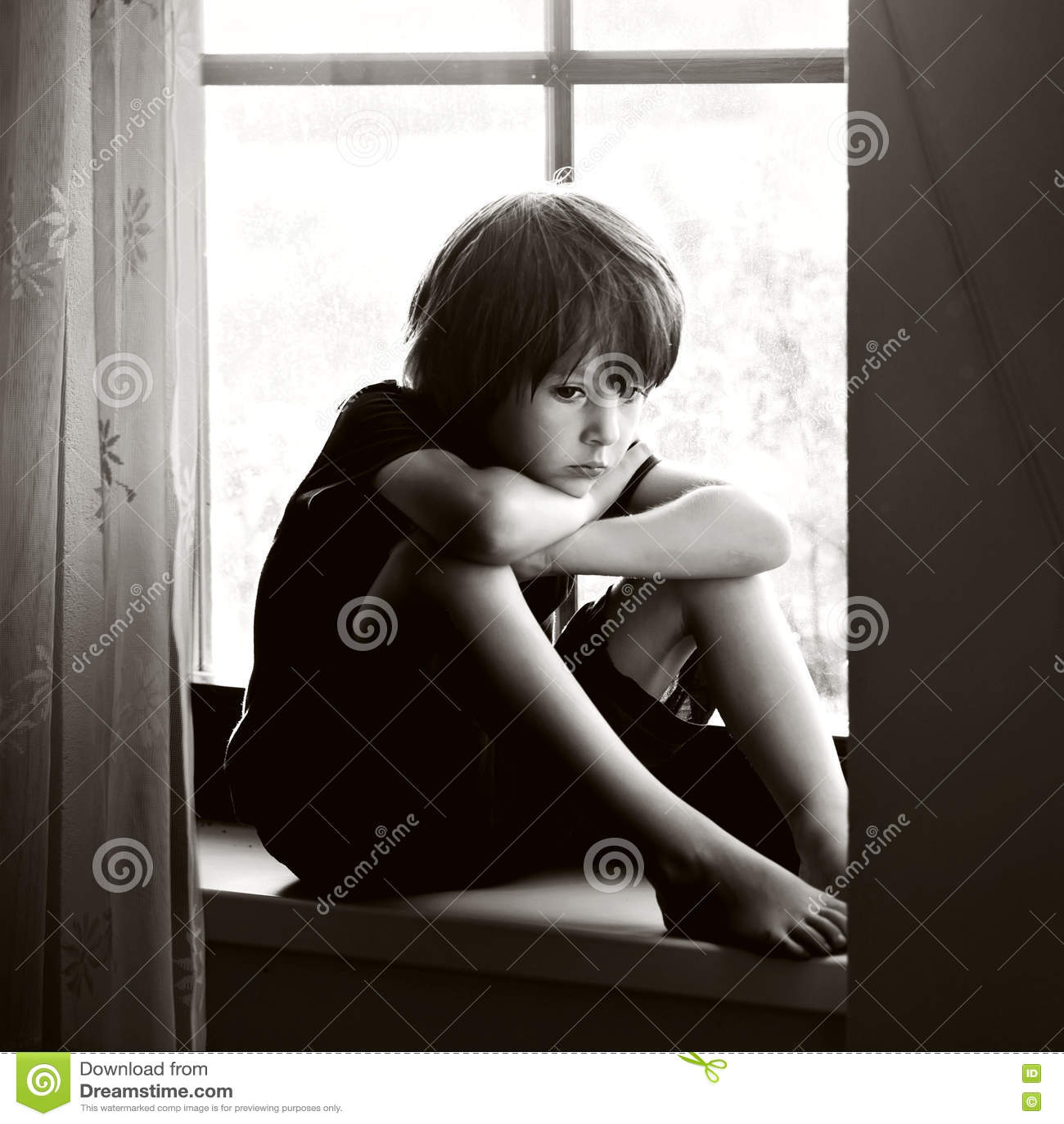 Sad Boy Alone Quotes: Sad Child, Boy, Sitting On A Window Shield Stock Photo