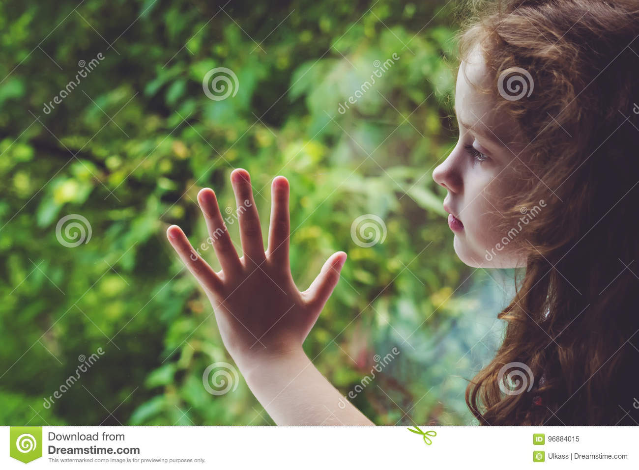 Sad Child Looking Out The Window  Stock Image - Image of