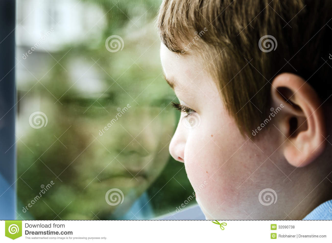 sad child looking out window royalty free stock photos