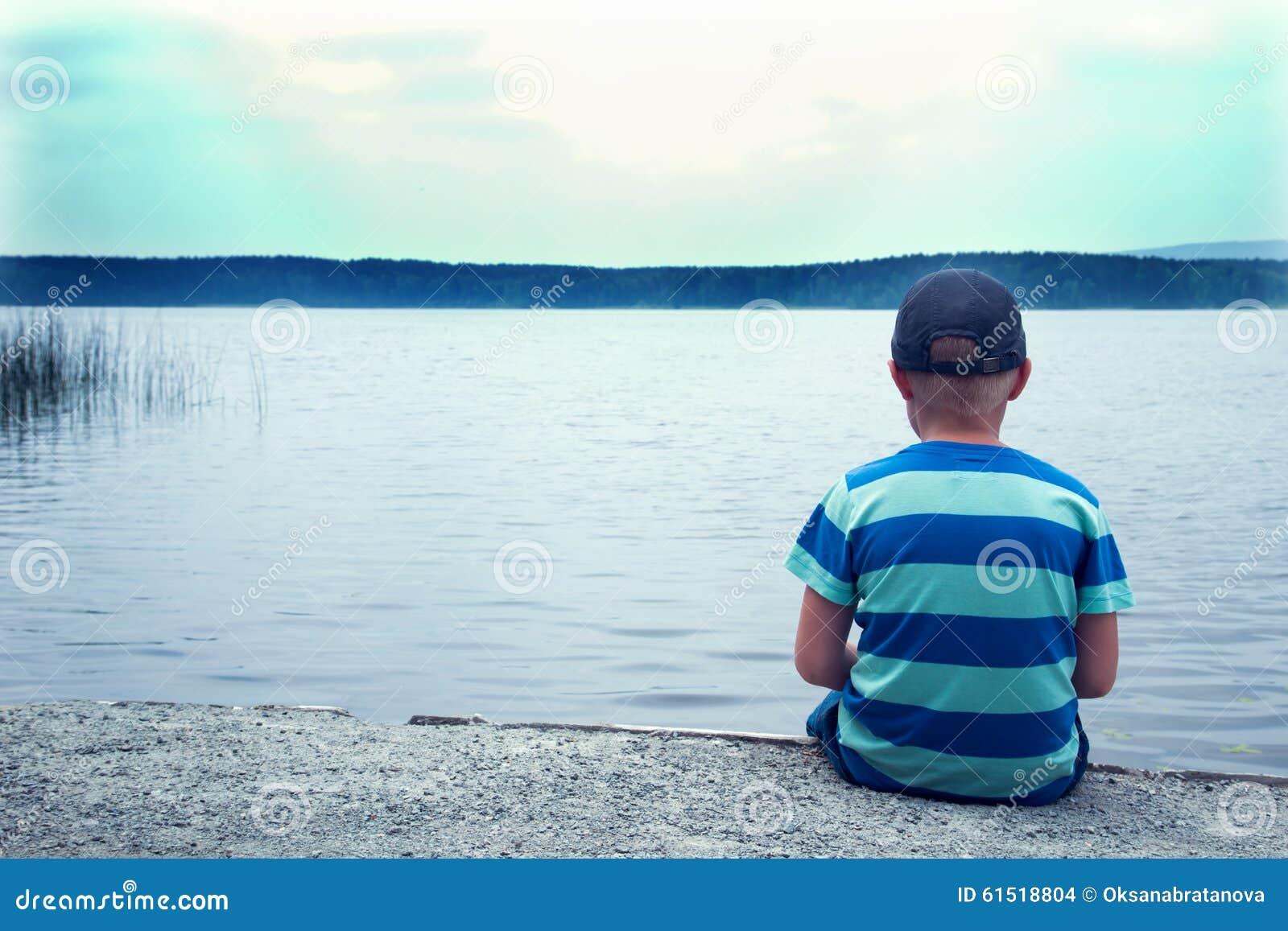 Group Of Sad Boy Sitting Alone