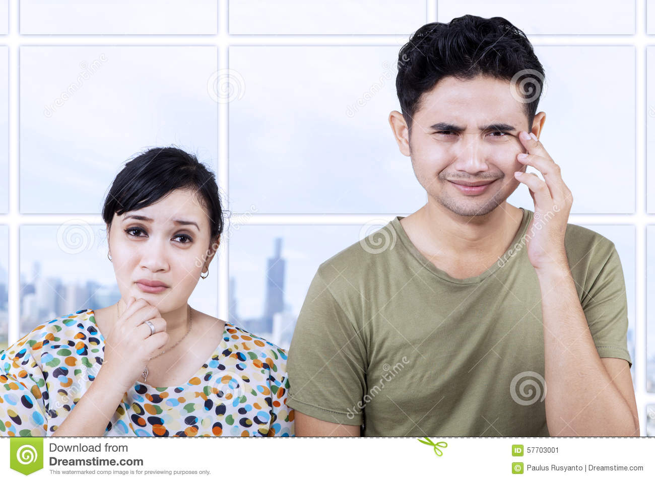 Sad couple expression in apartment