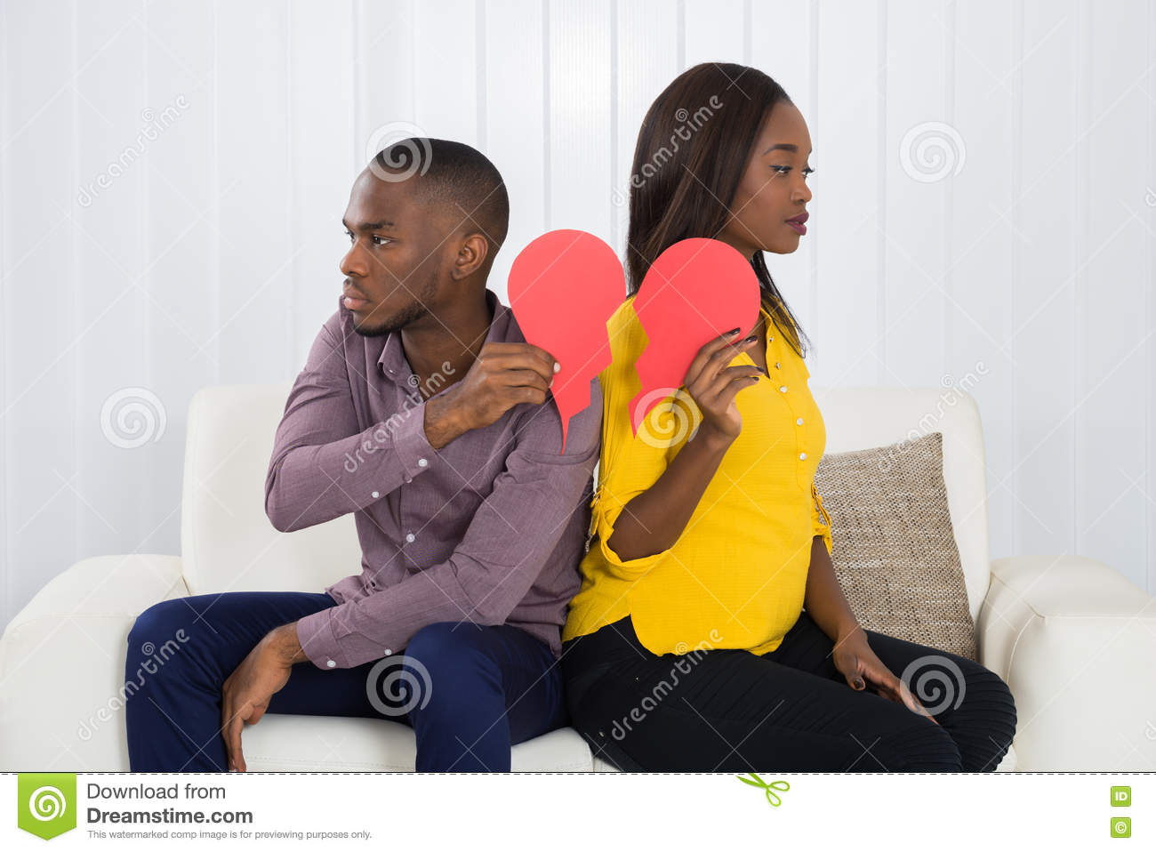 Download Sad Couple Holding Red Broken Heart Stock Photo - Image of broken, separation: 74153636
