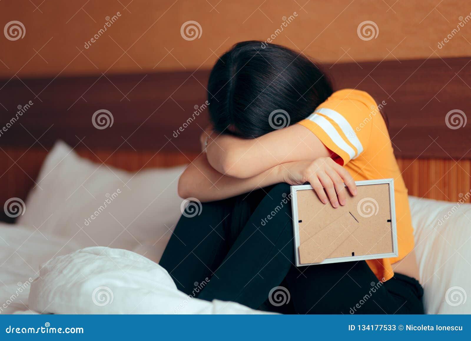 Sad Depressed Girl Crying After Break Up Holding Framed Picture Stock Image Image Of Emotional Dead 134177533