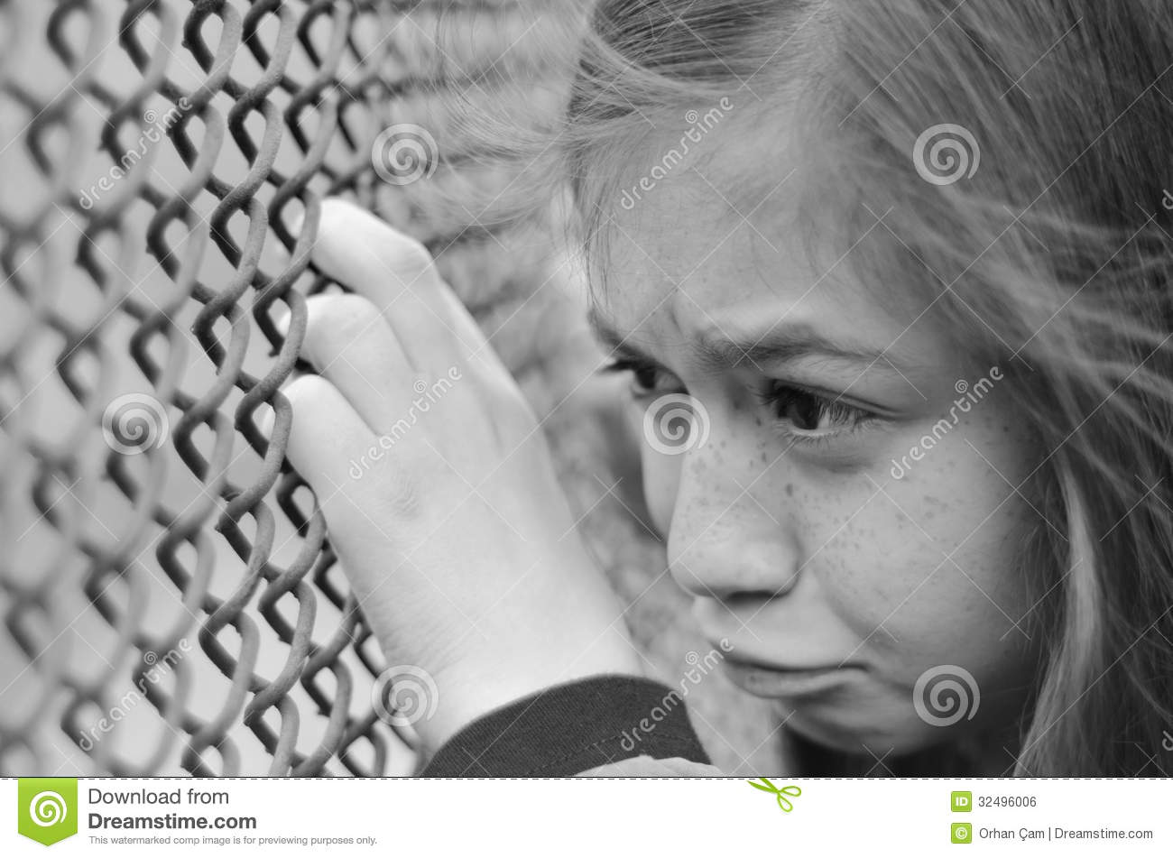 Sad depressed girl with rusty fence - black and white