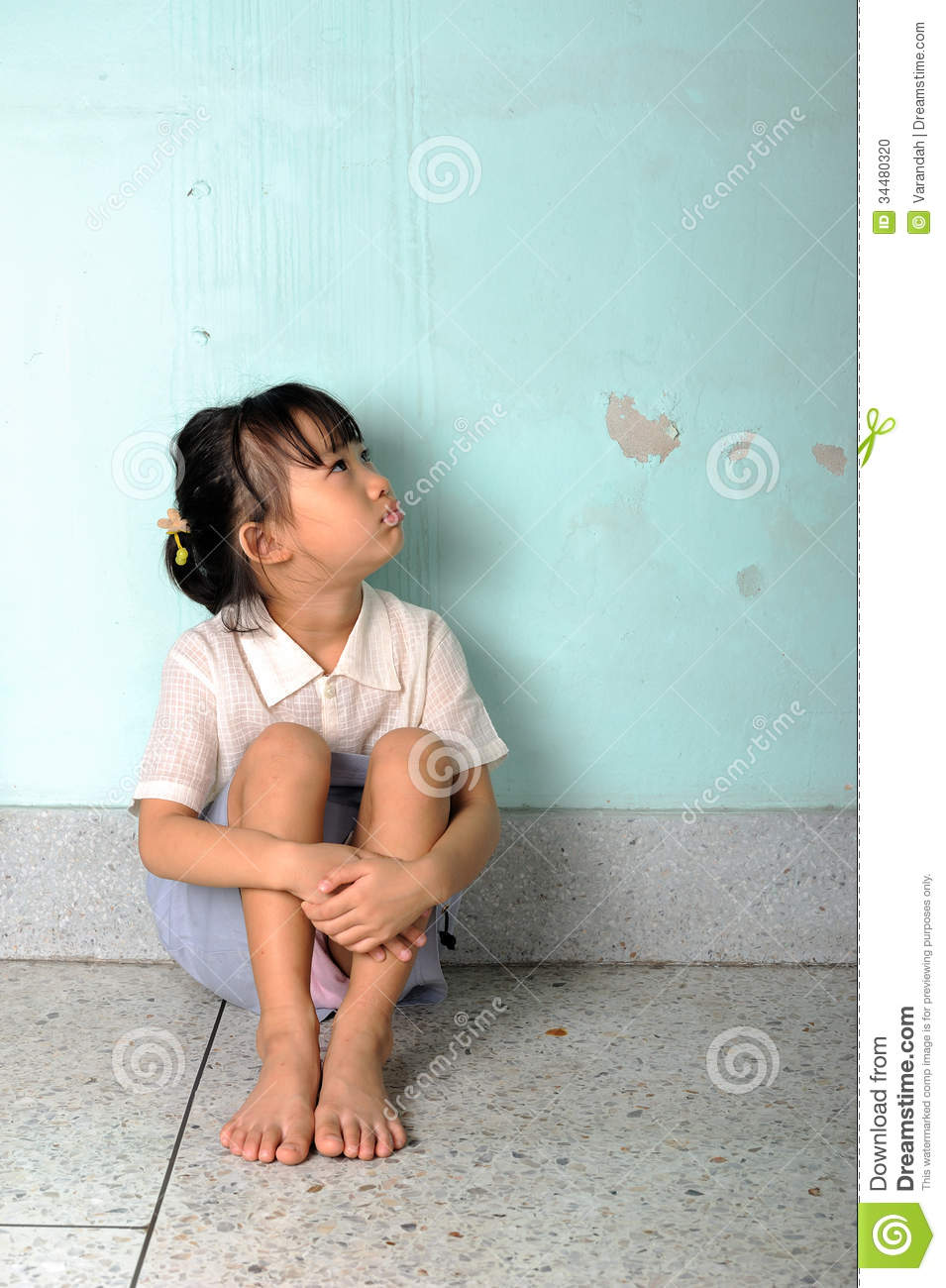 Sad Girl Sitting Alone Outside Stock Photos Sad Girl: Sad And Depressed Little Girl Sitting Near The Wall Stock