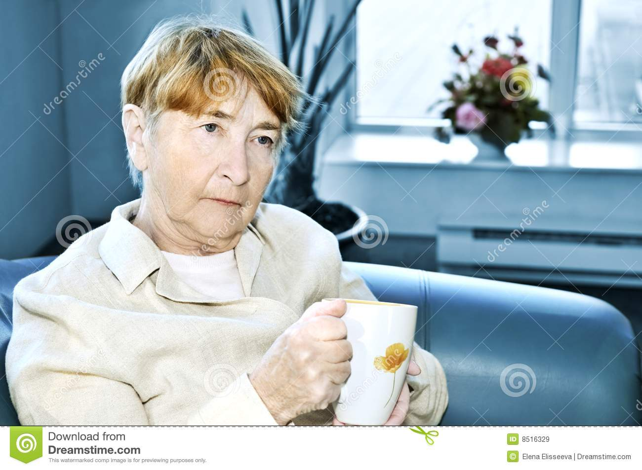 Sad elderly woman