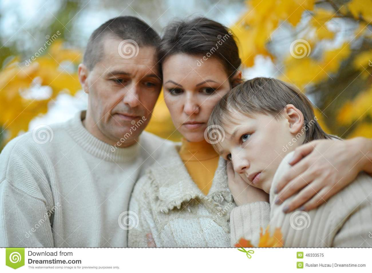 Sad family of three