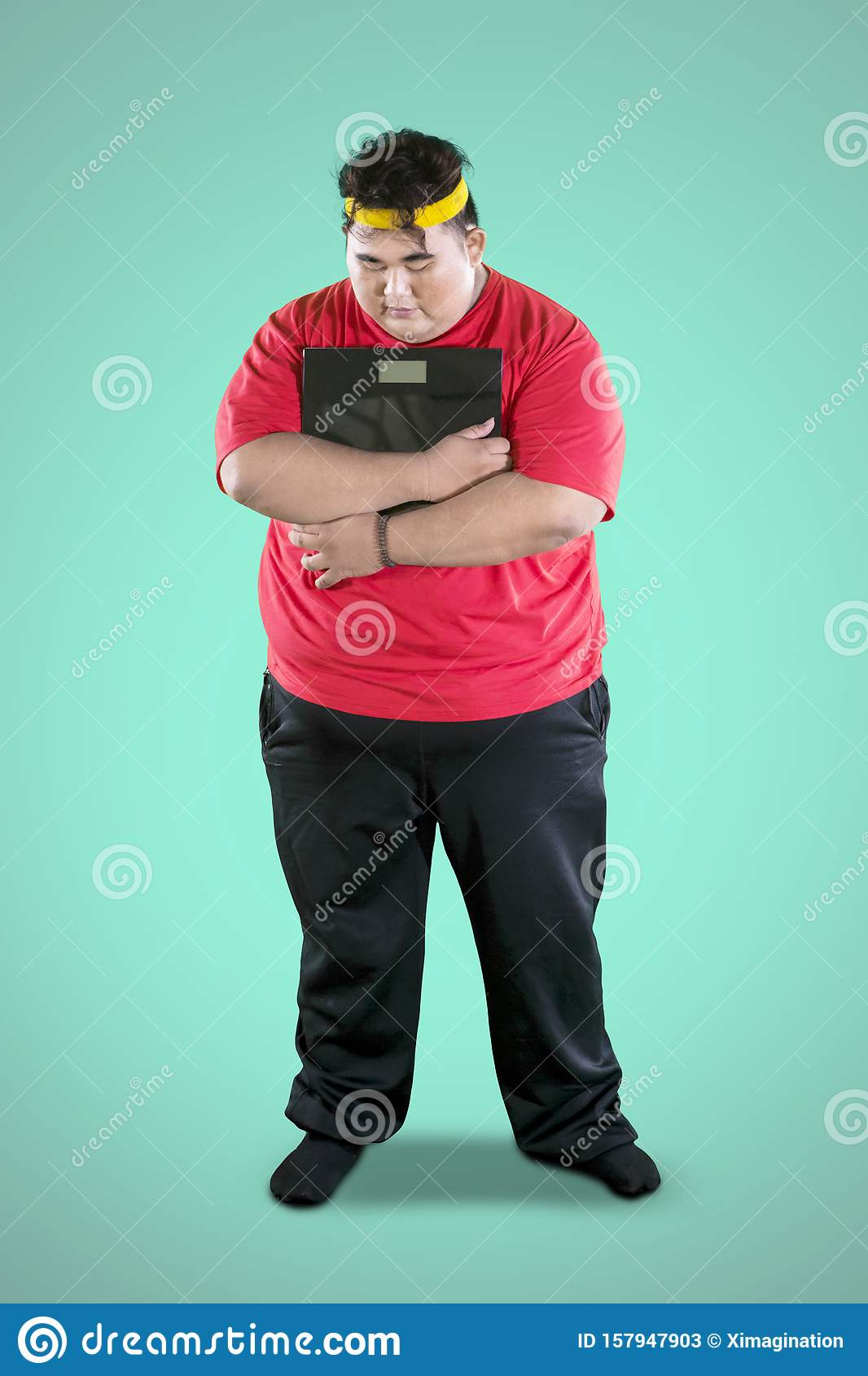 Sad Fat Man Holding A Weight Scale On Studio Stock Image