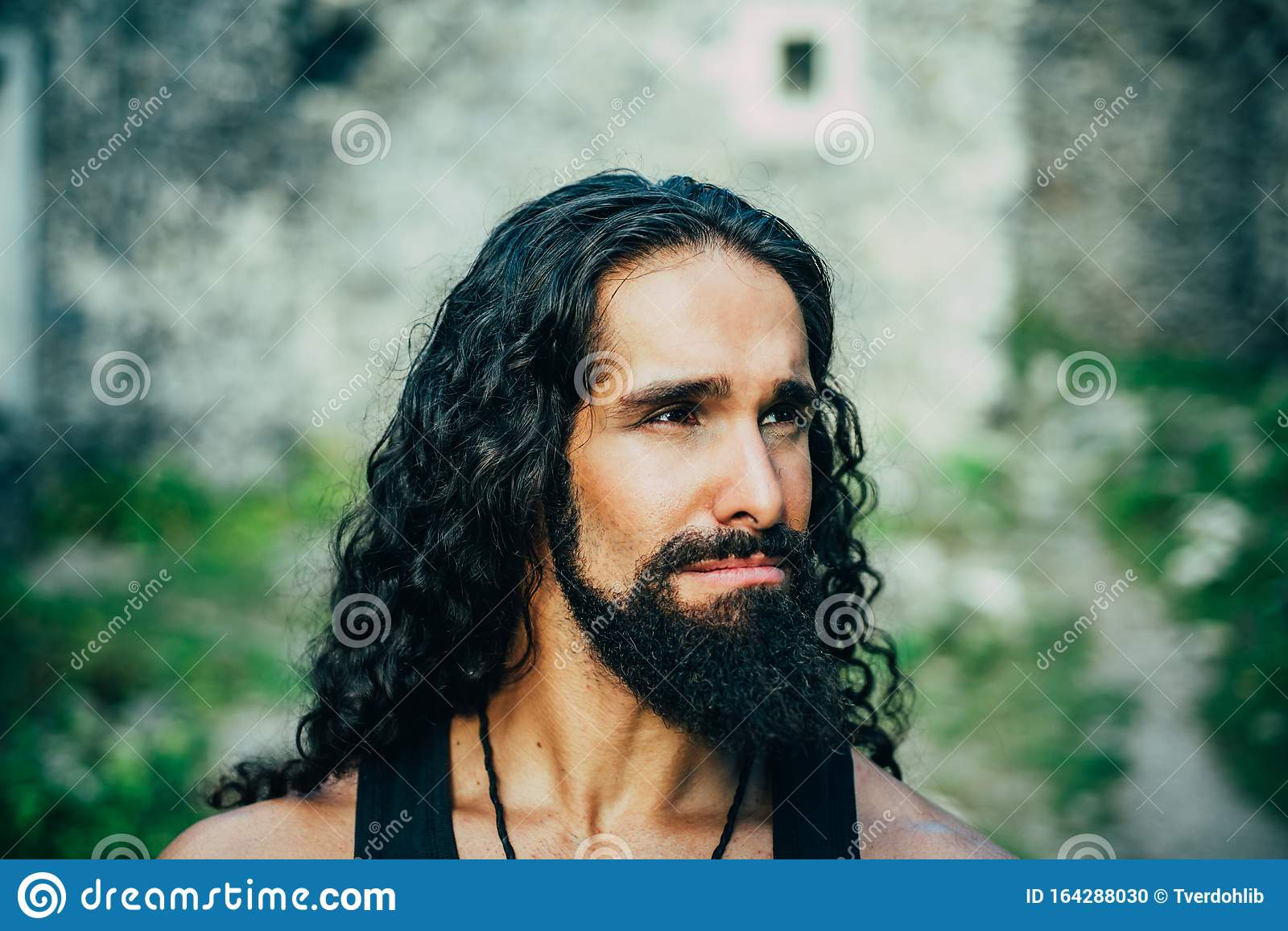 Sad Frustrated Man With Long Dark Wavy Hair And Beard Looking Far Away Portrait Of Handsome Man With Disappointed Face Stock Photo Image Of Outside Macho 164288030