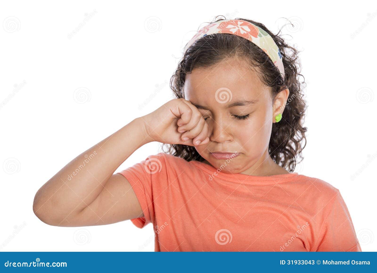 Sad young girl crying isolated on white background