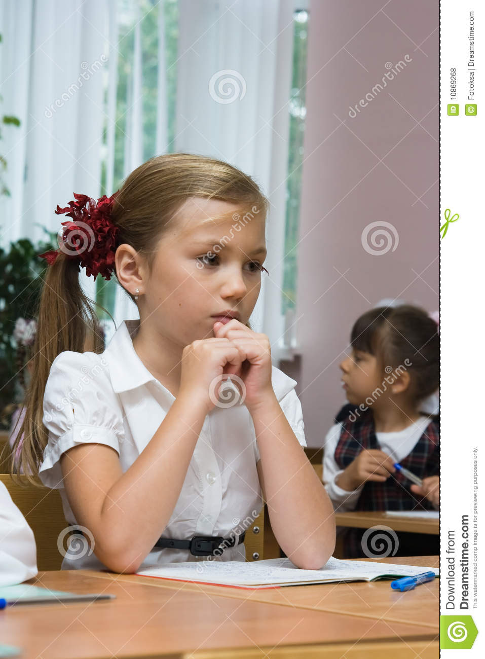 The Sad Girl Sits At A School Desk Royalty Free Stock ...