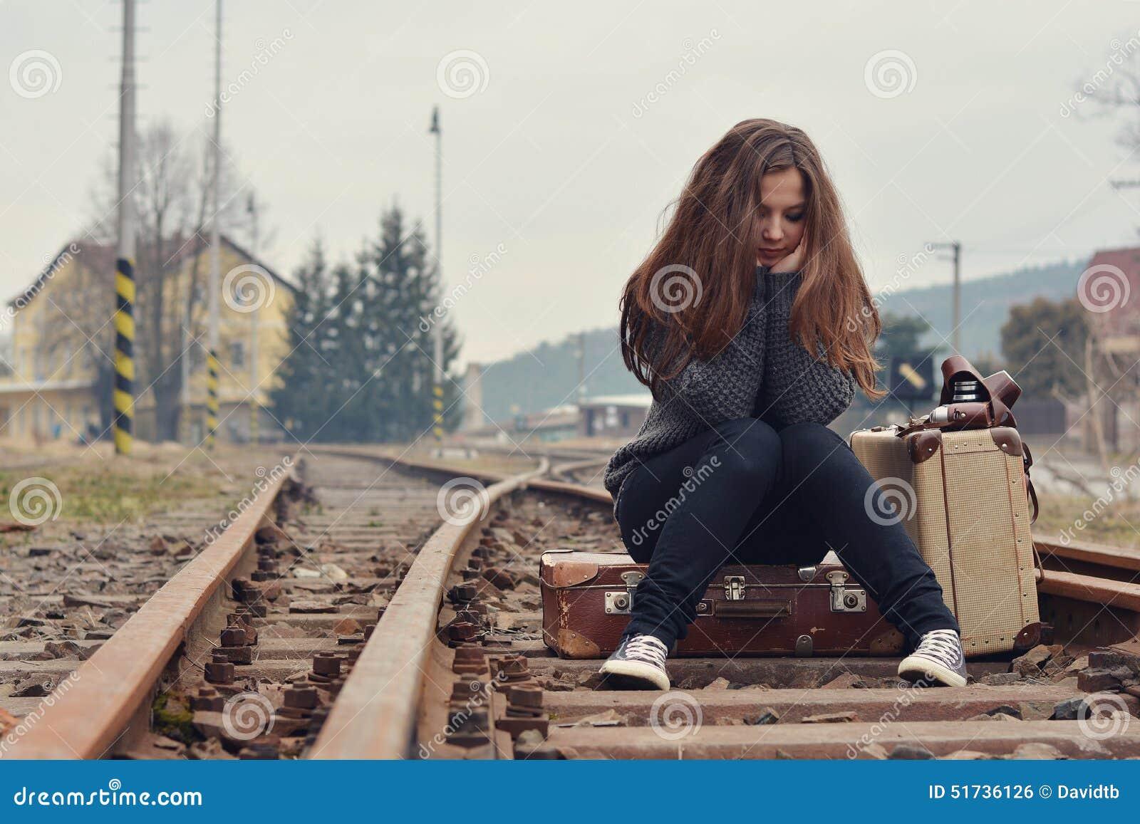 a sad girl on railway tracks Stock Photo: 57062504 - Alamy