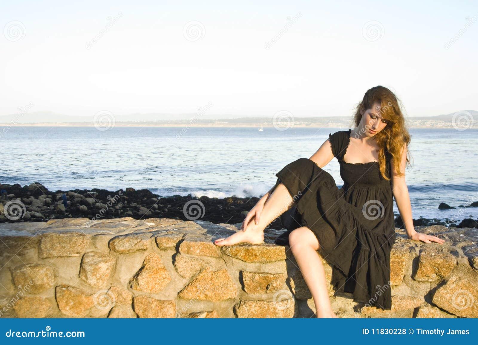 Sad Girl Sitting On A ...