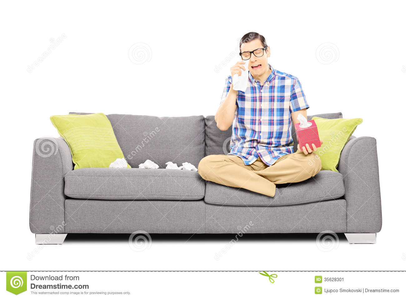 Sad Guy Sitting On A Couch And Wiping His Eyes From Crying Stock ...