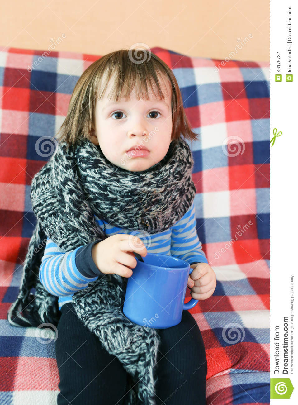 Sad Ill 2 Years Child In Warm Woolen Scarf With Cup Of Tea