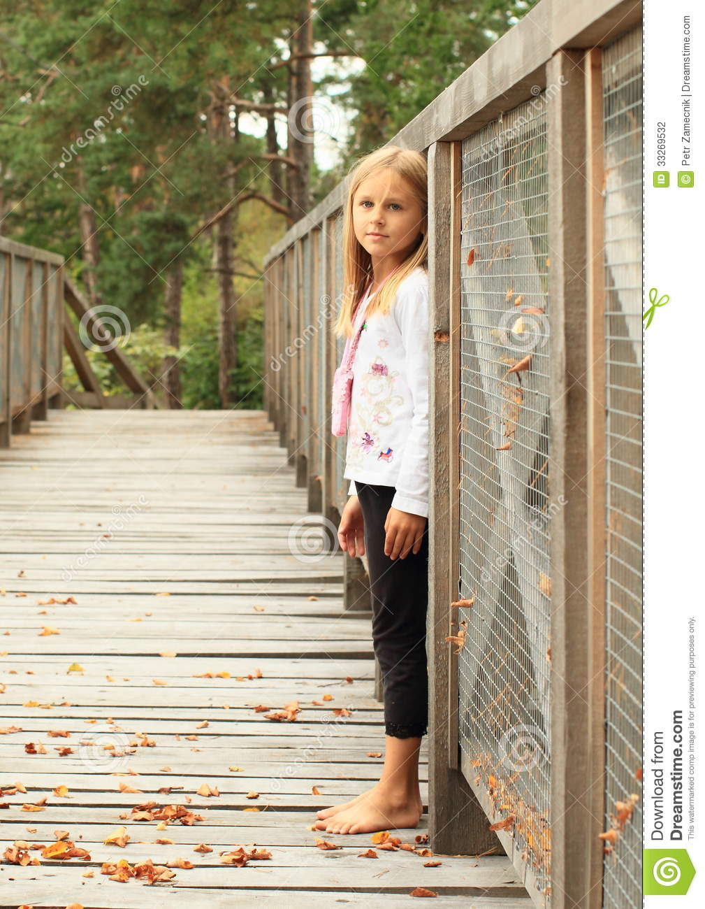 sad little girl on bridge stock photo image of barefeet