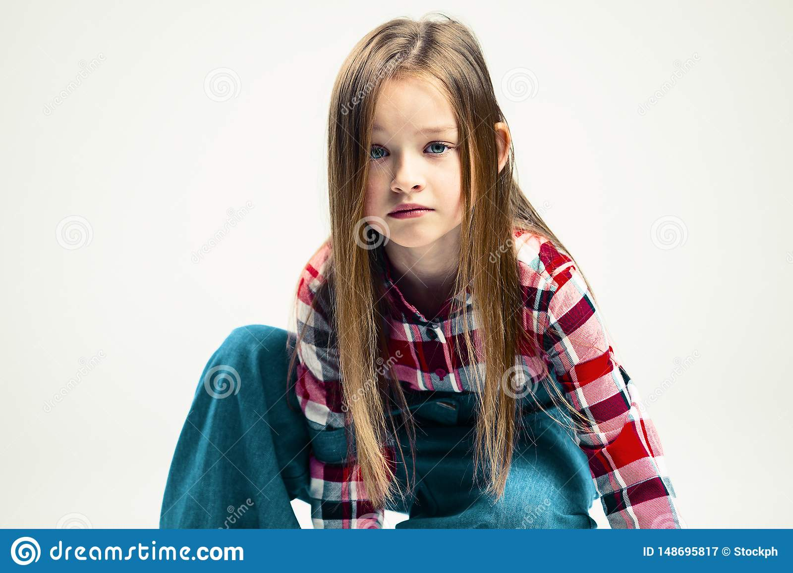 Sad little girl. emotional portrait of a child. fashion studio shooting