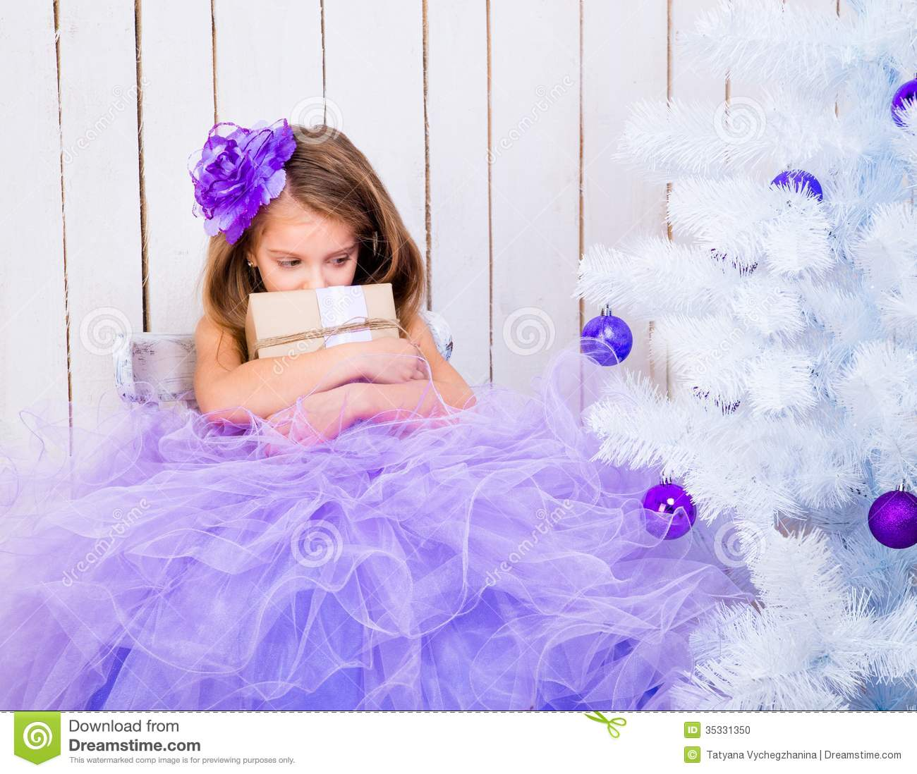 Sad Little Girl With A Gift Stock Photo - Image: 35331350