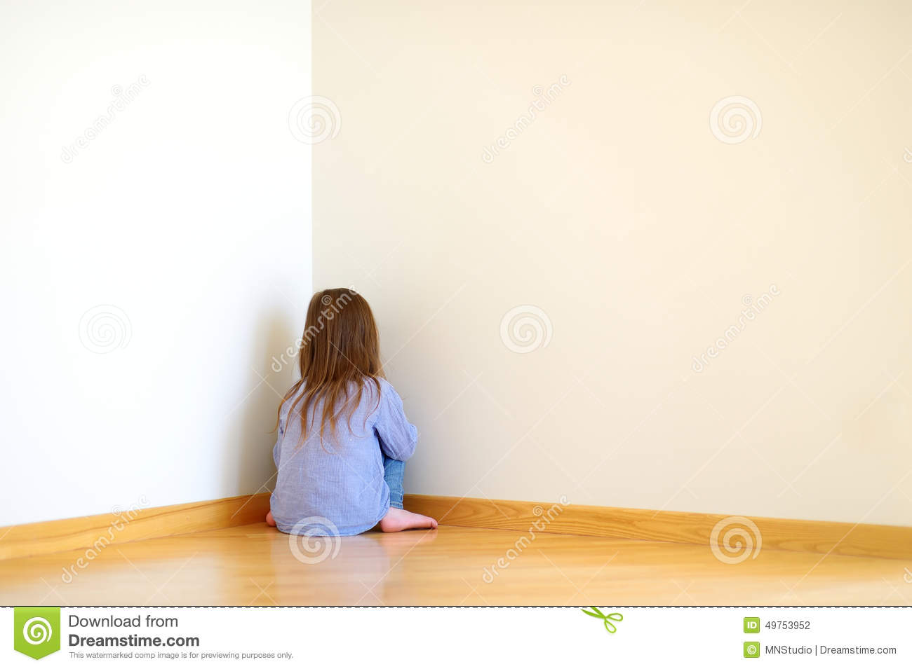 Sad Little Girl Sitting In A Corner Stock Photo   Image  49753952