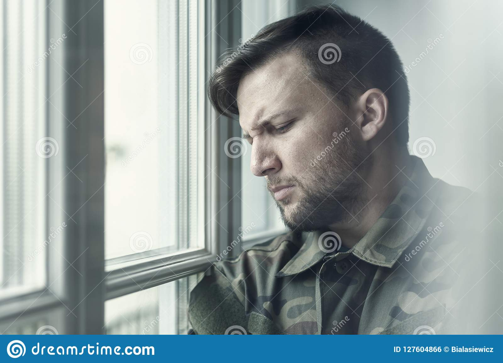 Sad and lonely soldier in depression after war with emotional problem