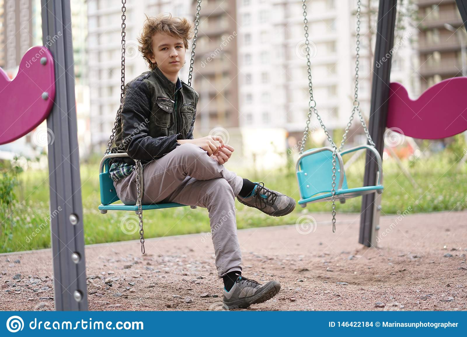 Sad lonely teenager outdoor on the Playground. the difficulties of adolescence in communication concept.