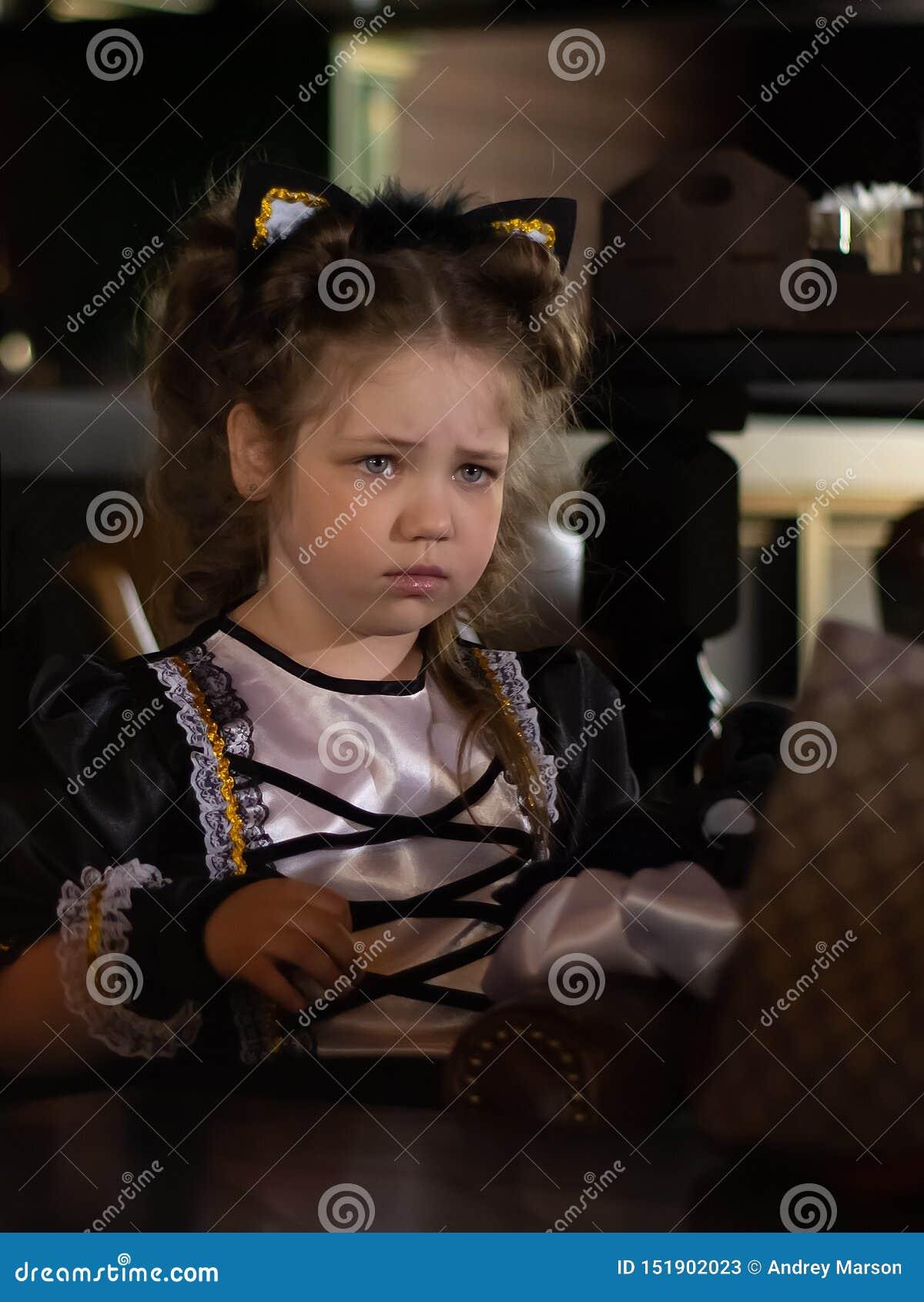 Sad look of little girl. Close up portrait