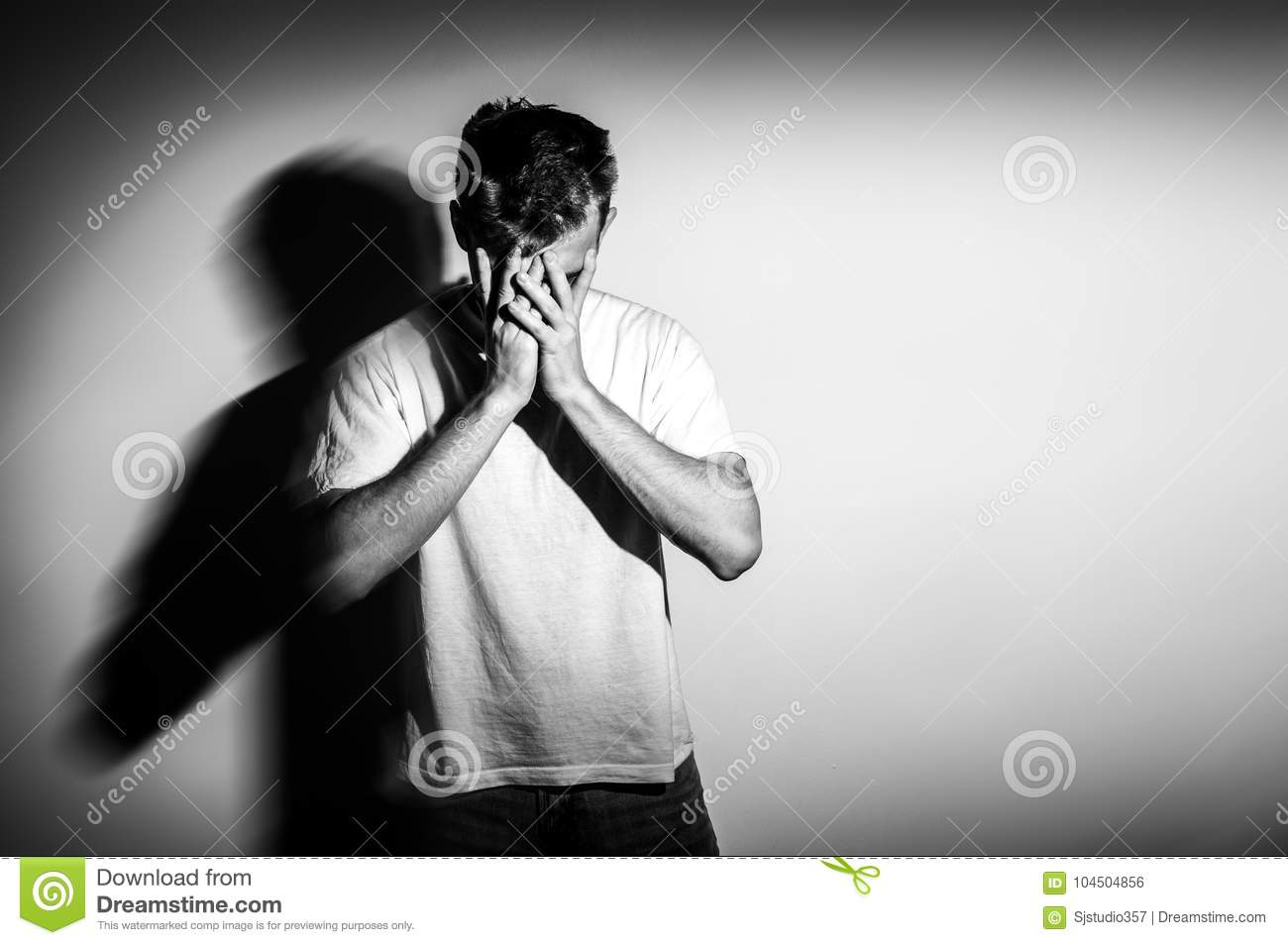 Sad man with hands on face in sadness on white background black and white photo free