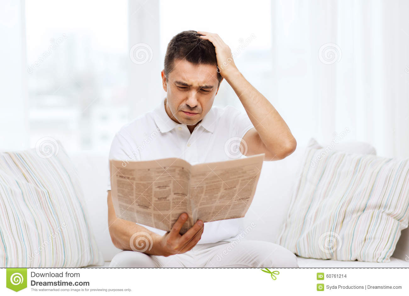 sad man reading newspaper stock photos - royalty free pictures