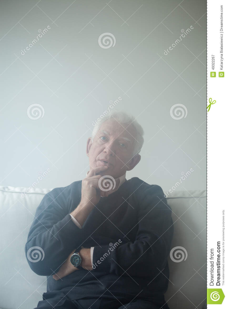 Sad Man Sitting On The Sofa Stock Image - Image: 49322267