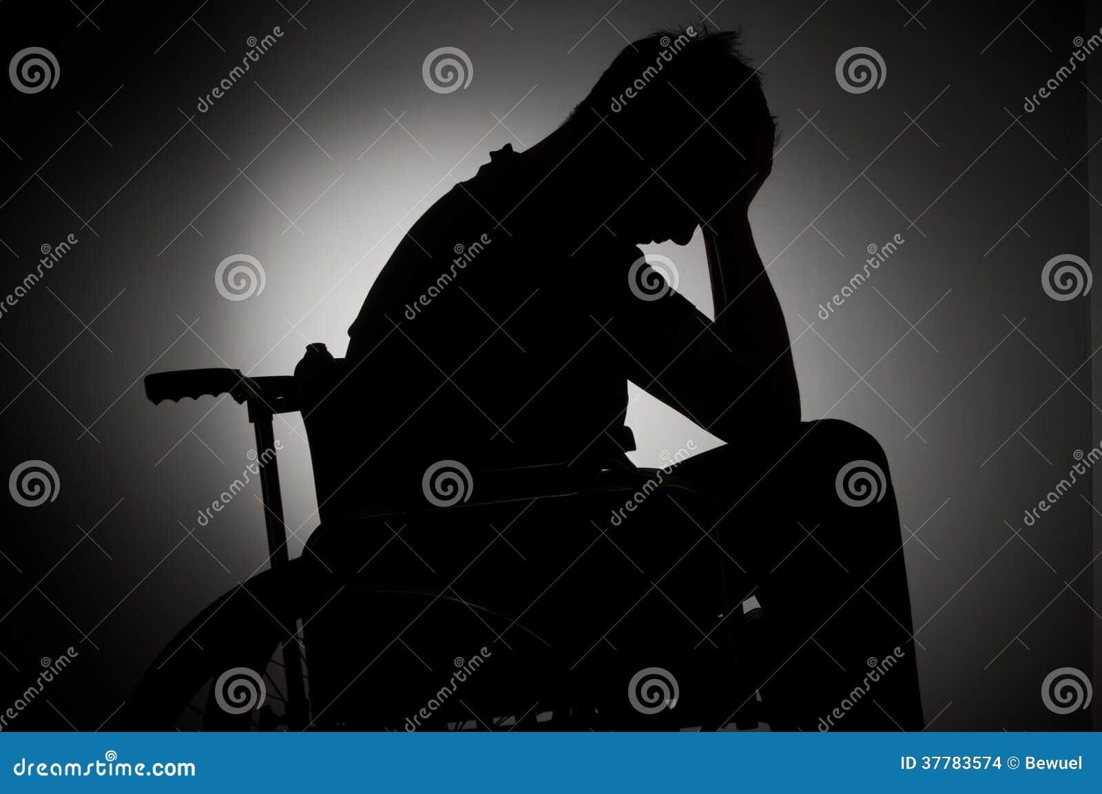 Sad man sitting on wheelchair