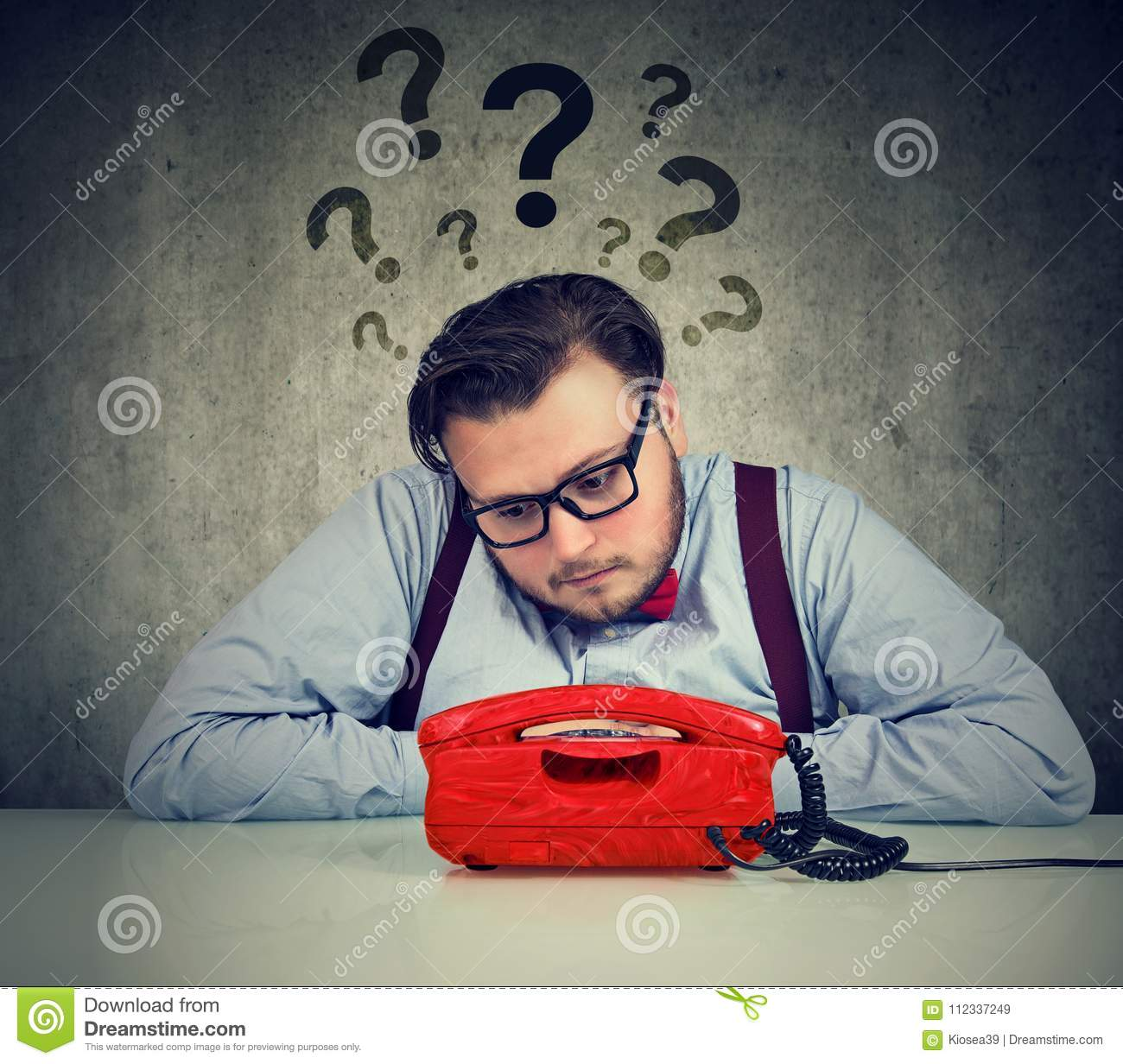 Worried man with too many questions waiting for a call