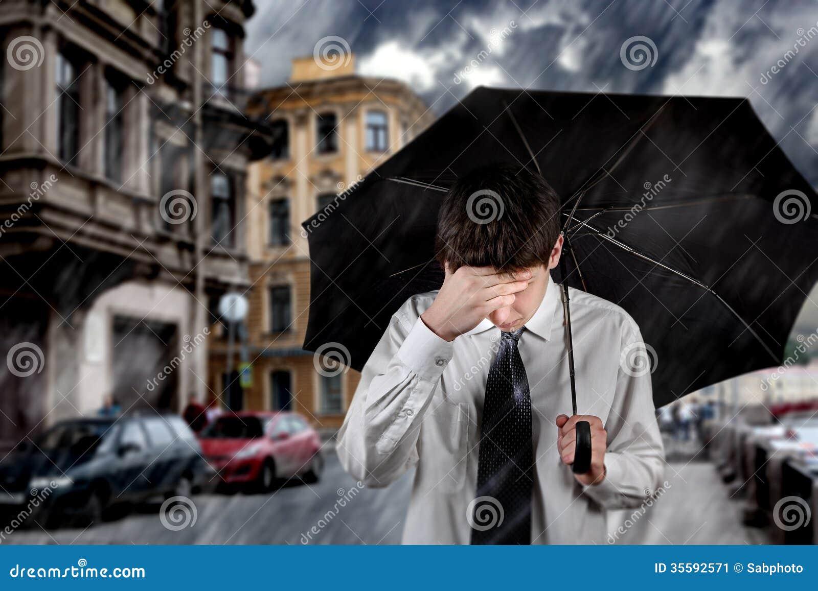 Sad Man Under The Rain Stock Image - Image: 35592571