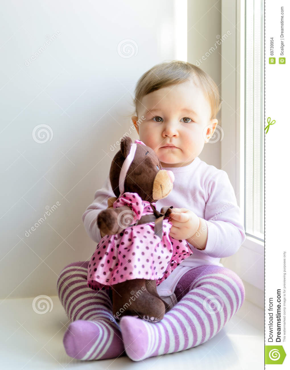 sad nice baby girl with toy bear stock photo - image of child