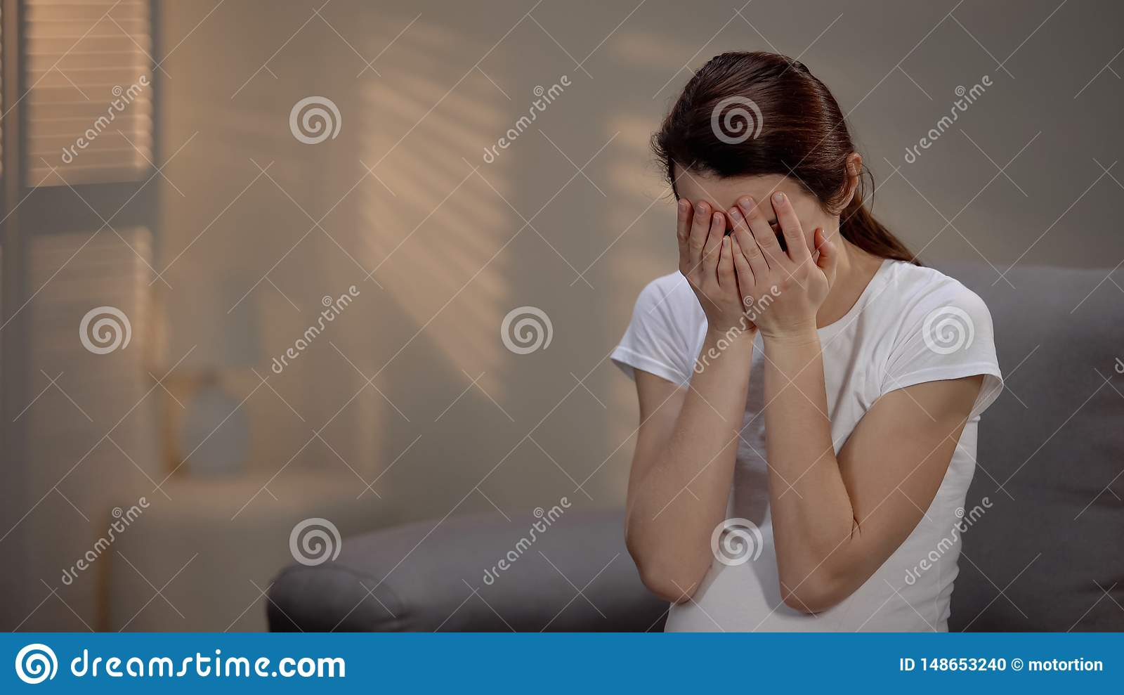 Sad pregnant woman crying, suffering prenatal depression, single motherhood