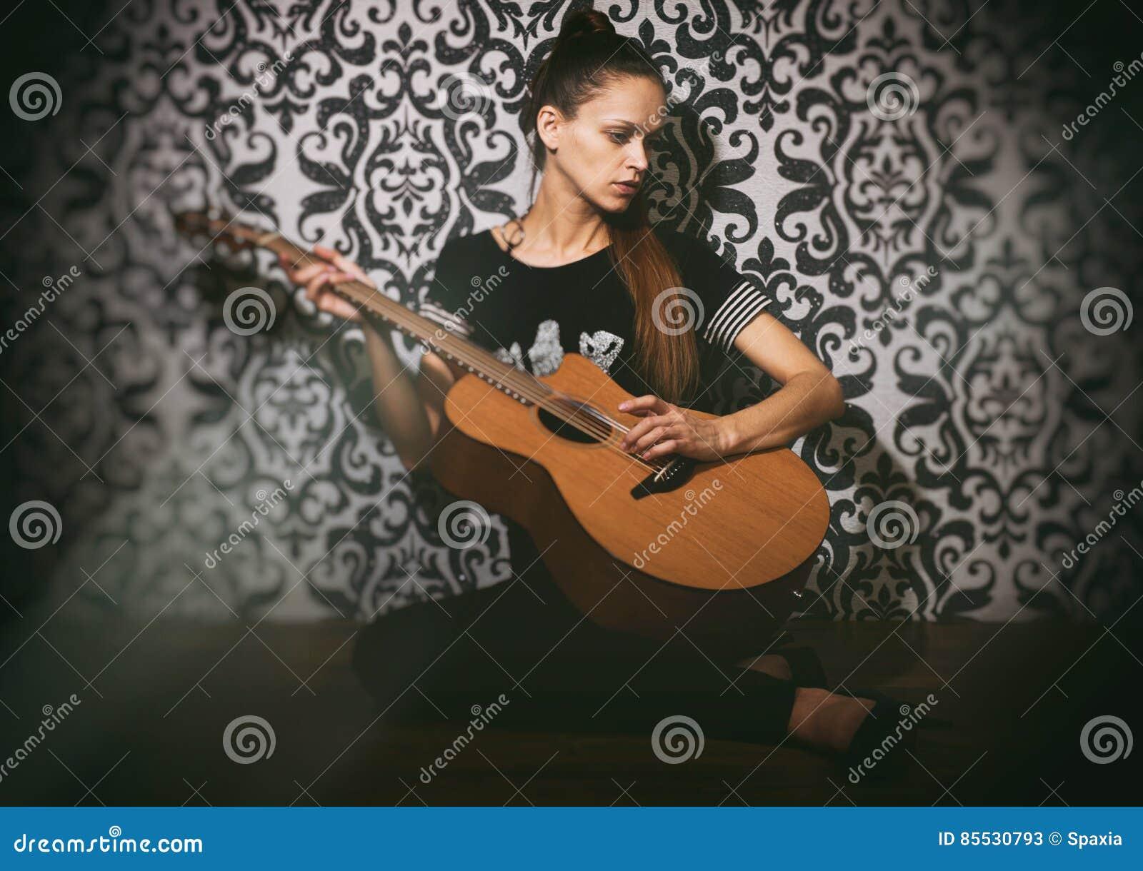 Sad pretty girl with guitar