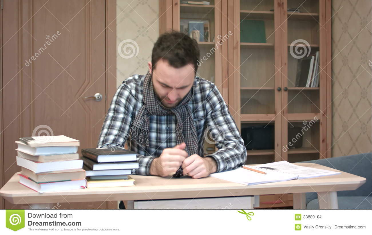 Sad And Sick Student Getting Down With Flu Sitting At The Desk With Books  Stock Footage   Video Of Learn, Examination: 83889104