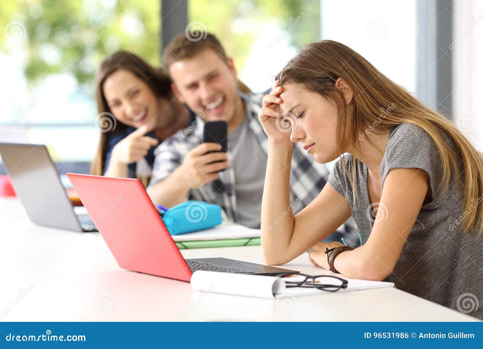 Sad student victim of cyber bullying