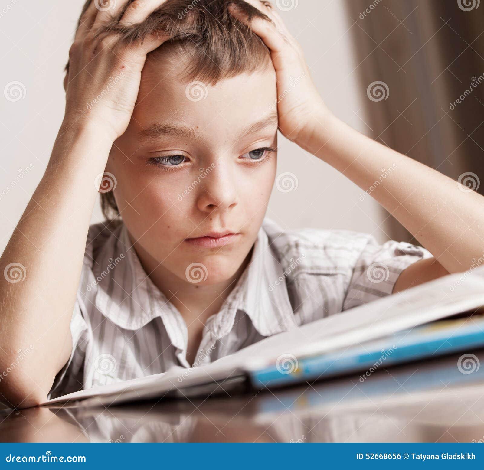 Sad: Sad Teen Doing Homework Stock Photo
