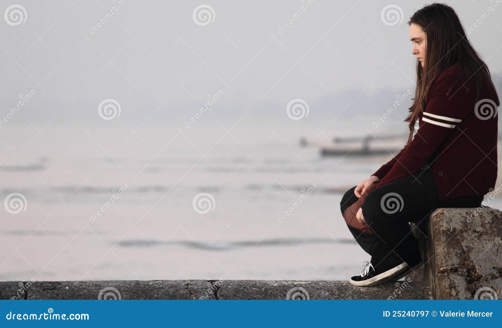 sad-looking teenage gi...