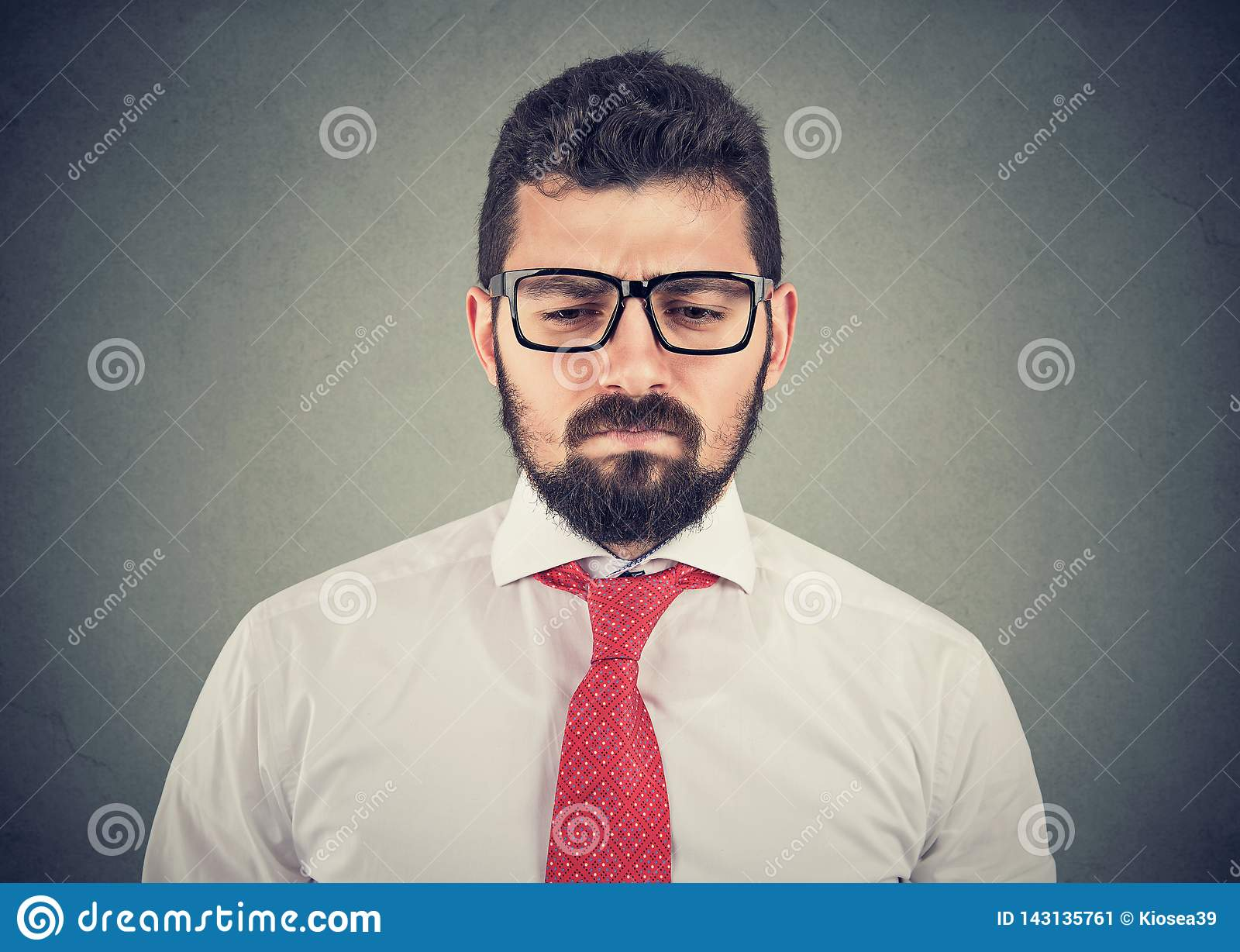 Sad thoughtful worried young businessman