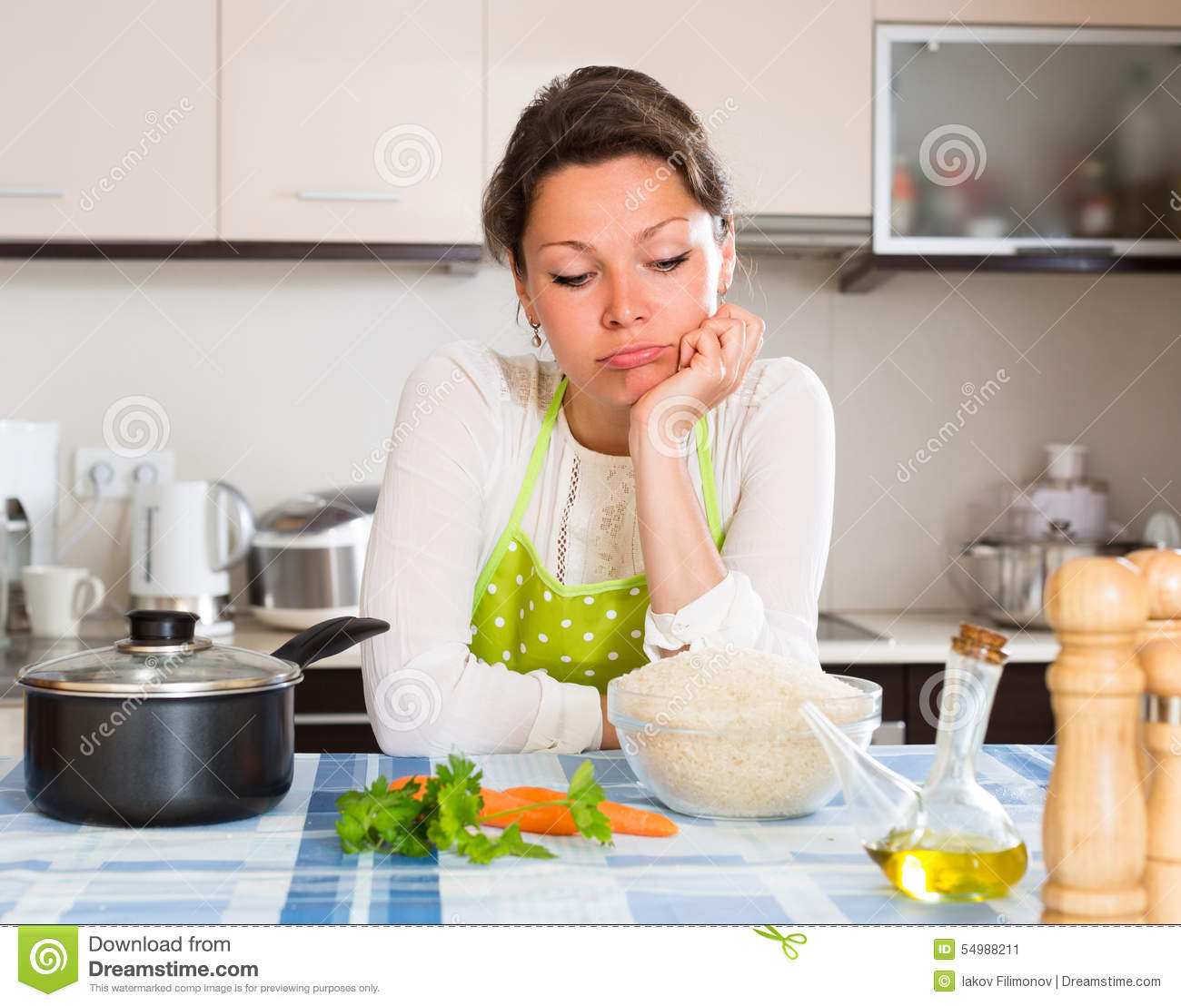 Sad Woman Cooking Rice In The Kitchen Stock Image - Image ...