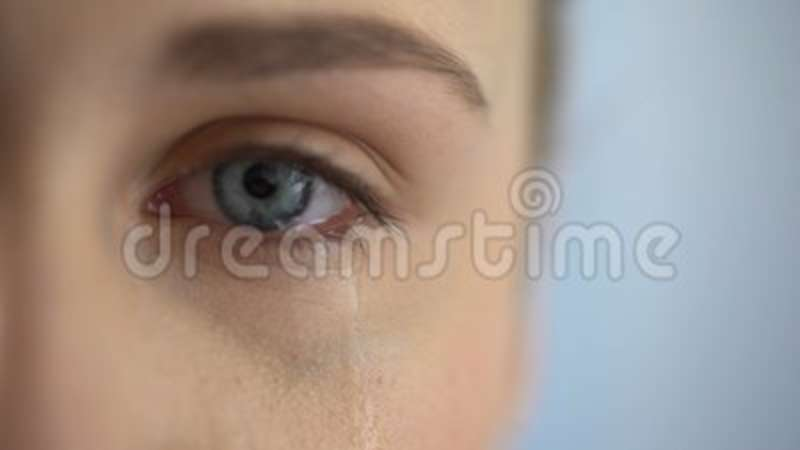 sad woman crying suffering pain eyes full of tears domestic