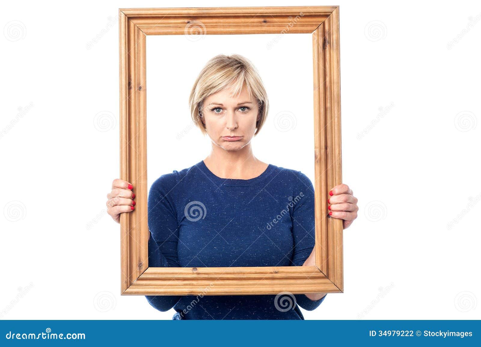 Woman holding frame. stock photo. Image of framed, holding - 2678186