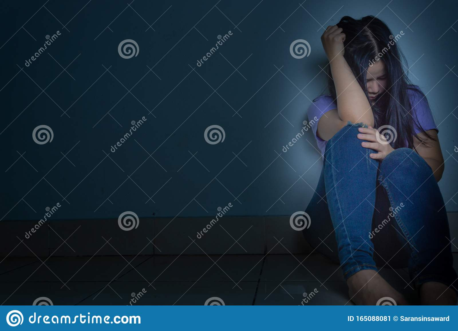 Sad Woman Hug Her Knee And Cry Sitting Alone In A Dark ...