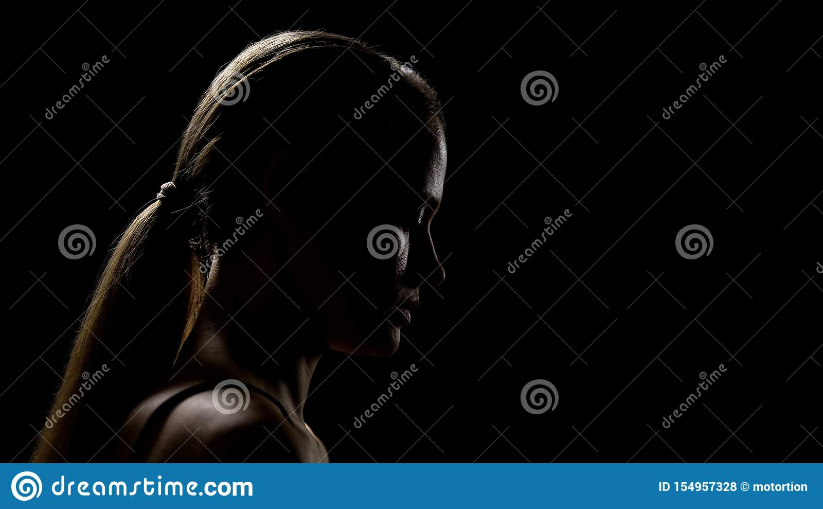 Sad woman looking down having life difficulties, feeling frustrated and insecure